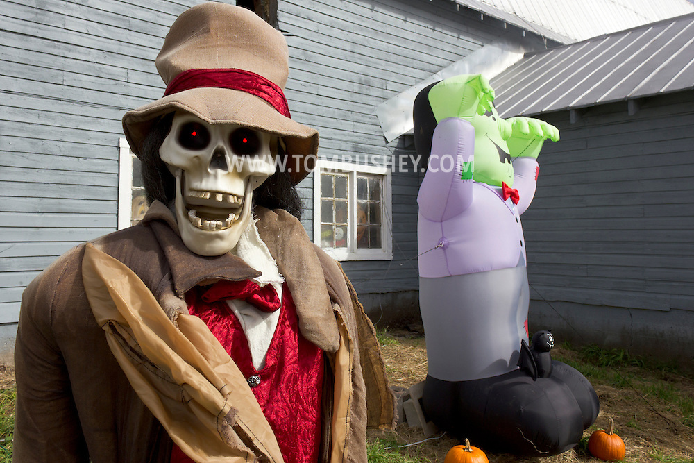 Mount Hope, New York - A skull with red eyes and an inflatable monster outside the haunted barn at Pierson's Farm on Oct. 20, 2012.