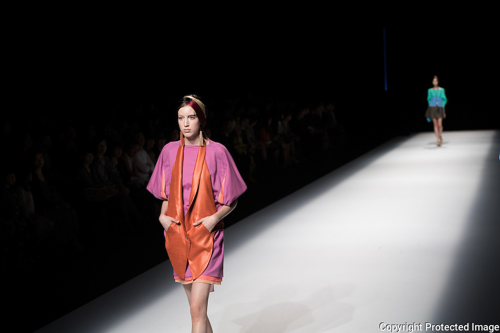 OCTOBER 21: A model  presents the Yuma Koshino collection at the Amazon Fashion Week Tokyo's 2017 Spring/Summer show under way at Shibuya Hikarie in Tokyo on Oct. 21, 2016. and other locations through 23rd. The designer Yuma Koshino is Graduating from Graduate Course of Bunka Fashion College, Yuma Koshino went to Paris and studied as a trainee at the atelier of Kenzo Takada. (91). After experiencing MICHIKO LONDON KOSHINO (92), HIROKO KOSHINO Design Office (97), she released YUMA KOSHINO collection in 1998. She tied up with HIROKO KOSHINO International Co.,Ltd. in 2006, and began to take full effect in her brand. She also produces uniform and black formal wear. She became a project professor at Bunka Gakuen University in 2015.Nearly 50 fashion brands and companies will hold their shows at several locations through 23rd.. 21/10/2016-Tokyo, JAPAN