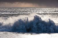 Waves poundng at Reynisfjara black sand beach, south shore Iceland.