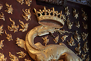 Salamander breathing fire with crown, symbol of Francois I, on the fireplace in the Salle du Conseil or Council Room, the site of the assassination of the Duc de Guise in 1588, on the second floor of the Francois I wing, built early 16th century in Italian Renaissance style, at the Chateau Royal de Blois, built 13th - 17th century in Blois in the Loire Valley, Loir-et-Cher, Centre, France. The murder is retold in several 19th century paintings hung in the room. The chateau has 564 rooms and 75 staircases and is listed as a historic monument and UNESCO World Heritage Site. Picture by Manuel Cohen