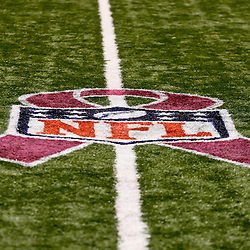 October 3, 2010; New Orleans, LA, USA; A NFL logo featuring a pink ribbon is seen painted on the turf for a game between the New Orleans Saints and the Carolina Panthers at the Louisiana Superdome. The NFL is supporting breast cancer awareness month with a pink initiative where players will wear pink equipment throughout the month of October.  Mandatory Credit: Derick E. Hingle