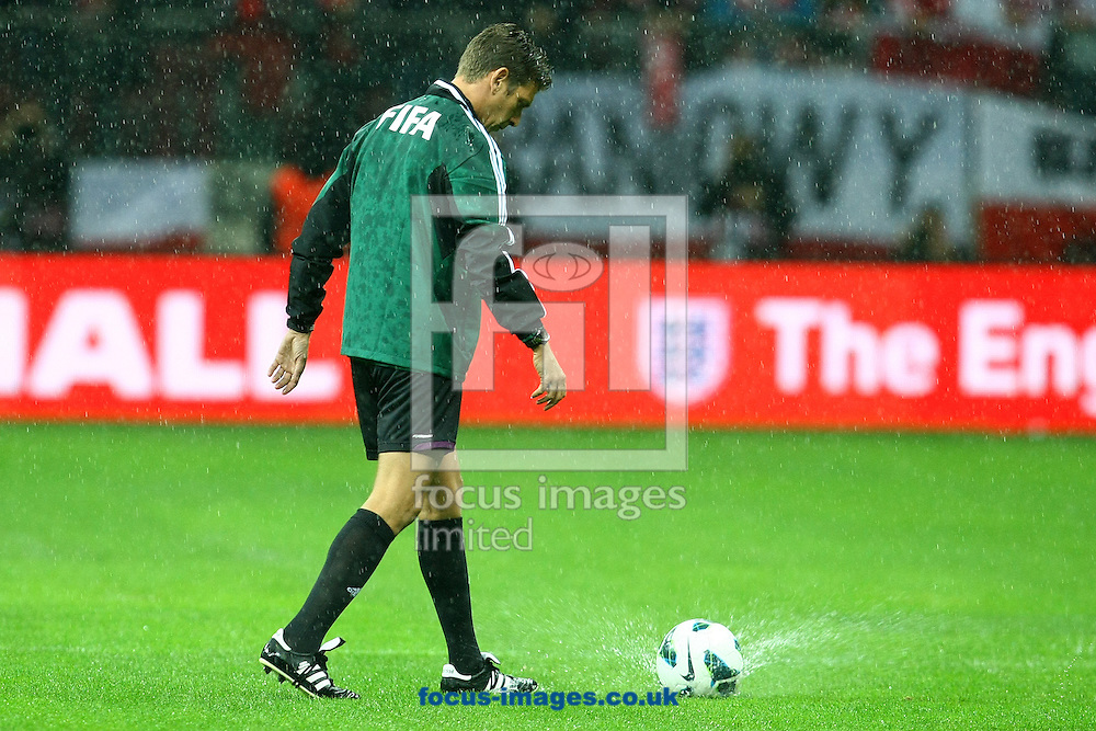 Picture by Paul Chesterton/Focus Images Ltd +44 7904 640267.16/10/2012.General views of the possibility of the match being called off including unhappy fans and the ref doing his pitch inspection before the 2014 FIFA World Cup Qualifying match at the National Stadium, Warsaw.