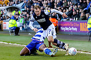 Millwall midfielder Jed Wallace (7) tussles with Reading midfielder Yakou Méïte (19) during the EFL Sky Bet Championship match between Millwall and Reading at The Den, London, England on 18 January 2020.