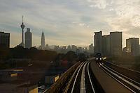 Entering the Malaysian city of Kuala Lumpur by train at dawn