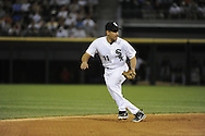 CHICAGO - JUNE 07:  Omar Vizquel #11 of the Chicago White Sox fields against the Seattle Mariners on June 7, 2011 at U.S. Cellular Field in Chicago, Illinois.  The White Sox defeated the Mariners 5-1.  (Photo by Ron Vesely)  Subject:  Omar Vizquel