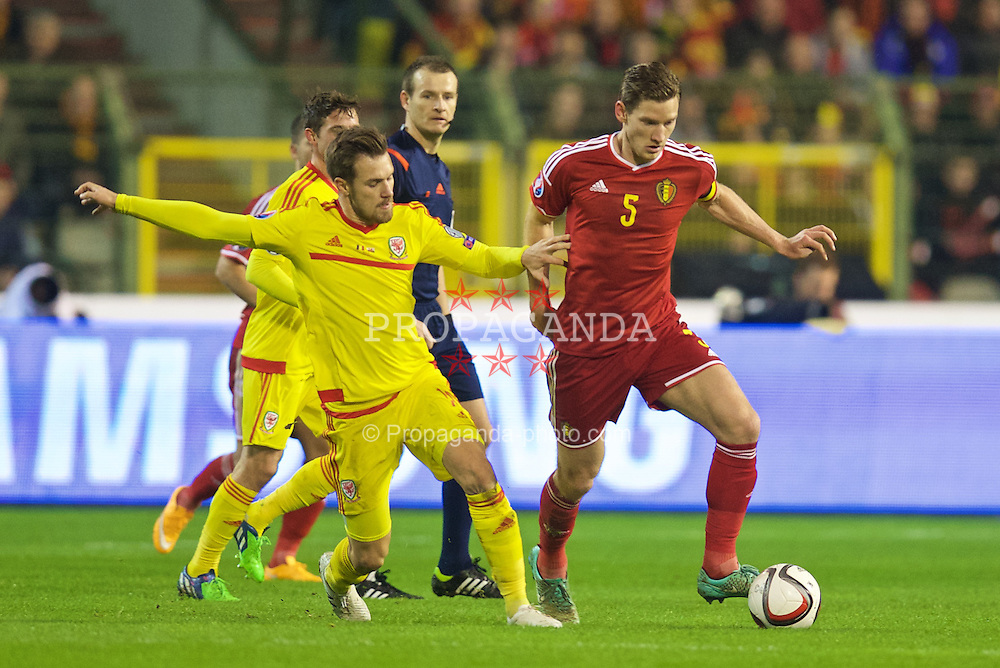 BRUSSELS, BELGIUM - Sunday, November 16, 2014: Wales' Aaron Ramsey and Belgium's captain Jan Vertonghen during the UEFA Euro 2016 Qualifying Group B game at the King Baudouin [Heysel] Stadium. (Pic by David Rawcliffe/Propaganda)