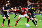 Middlesbrough midfielder Marcus Tavernier (7) attempts to shield the ball from Charlton Athletic midfielder Alfie Doughty (45) and Charlton Athletic defender Adam Matthews (2)  during the EFL Sky Bet Championship match between Middlesbrough and Charlton Athletic at the Riverside Stadium, Middlesbrough, England on 7 December 2019.