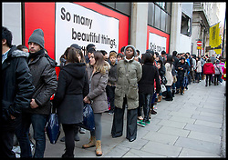 People queue to enter The Selfridges Sale on a busy Oxford Street in Central London as bargain hunters shop in the  Boxing Day Sales, Monday December 26, 2011. Photo By Andrew Parsons/i-Images