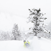 Forrest Jillson skis the motherload of cold smoke powder during a major winter storm in the backcountry of the Tetons.