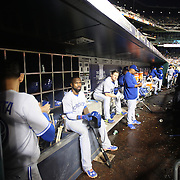 Jose Bautista, (left) and Jose Reyes, (center), Toronto Blue Jays, in the dugout preparing to bat during the New York Mets Vs Toronto Blue Jays MLB regular season baseball game at Citi Field, Queens, New York. USA. 16th June 2015. Photo Tim Clayton
