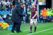 Craig Levein, manager of Heart of Midlothian speaks with Steven Naismith (#14) of Heart of Midlothian on the sidelines during the Betfred League Cup semi-final match between Heart of Midlothian FC and Celtic FC at the BT Murrayfield Stadium, Edinburgh, Scotland on 28 October 2018.