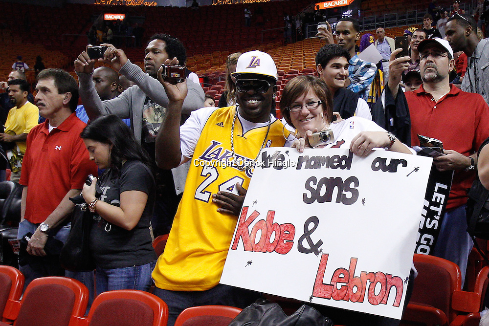 March 10, 2011; Miami, FL, USA; Fans hold up a sign prior to tip of a game between the Miami Heat and the Los Angeles Lakers at the American Airlines Arena.  Mandatory Credit: Derick E. Hingle