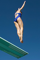 Female swimmer jumping on diving boards