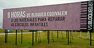"The embargo in Cuba has been in place for fifty years.  The government has not changed.  The message on the billboard reflects the reality, the political system has persisted, the people have been hurt.  The billboard reads, "" 8 hours of the blockade is the equvilant of enough materials to repair 40 kindergartens for children"""