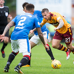 Craig Tanner of Motherwell tries to make his way through the Rangers defence, Motherwell v Rangers, Scottish Premiership, 6 August 2017 . (c) Adam Oliver | sportPix.org.uk