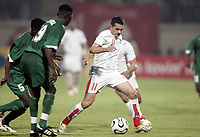 FOOTBALL - AFRICAN CUP OF NATIONS 2006 - FIRST ROUND - GROUP C - 060122 - TUNISIA v ZAMBIA JSANTOS (TUN) / ELIJAH TANA (ZAM) - <br />