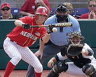 Nebraska's Steve Edlefsen (L) lays down a sacrifice bunt, scoring Jake Opitz from third in the top of the 4th inning against Kansas State.  Nebraska held on to be Kansas State 5-4 at Tointon Stadium in Manhattan, Kansas, April 1, 2006.