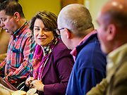 12 APRIL 2019 - NEVADA, IOWA: US Senator AMY KLOBUCHAR, (D-MN) in the conference room at Lincolnway Energy during a tour of the Lincolnway Energy ethanol plant in Nevada, IA. Sen. Klobuchar is touring Iowa this weekend to support her bid for the Democratic nomination of for the US Presidency. Iowa traditionally hosts the the first election event of the presidential election cycle. The Iowa Caucuses will be on Feb. 3, 2020.            PHOTO BY JACK KURTZ