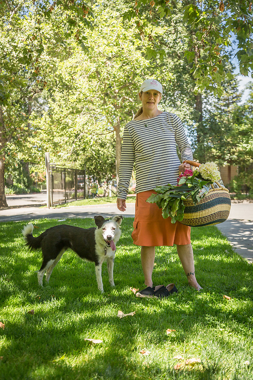 Wine maker and 14 year resident of Calistoga Julie Dumoland and her border collie, Tipper, return  from the Calistoga Saturday Market.