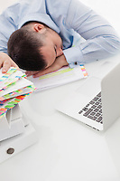 Close-up view of Caucasian businessman asleep at his desk
