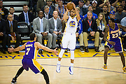 Golden State Warriors guard Stephen Curry (30) shoots a three pointer against the Los Angeles Lakers at Oracle Arena in Oakland, Calif., on November 23, 2016. (Stan Olszewski/Special to S.F. Examiner)