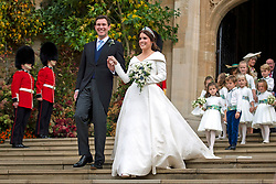 Princess Eugenie and her new husband Jack Brooksbank outside St George's Chapel in Windsor Castle following their wedding.
