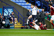 Northampton Towns Jak McCourt (12) gets the tackle on Bolton Wanderers Josh Vela (6) during the EFL Sky Bet League 1 match between Bolton Wanderers and Northampton Town at the Macron Stadium, Bolton, England on 18 March 2017. Photo by Craig Galloway.