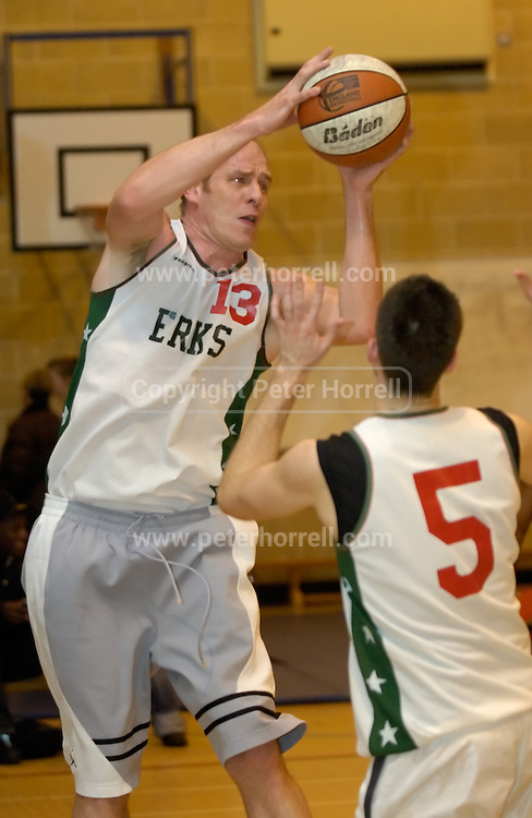 DAGENHAM - MAY 17: Barking and Dagenham Erkenwald Basketball Club's centre Dave Churches in action during the Essex Metropolitan Basketball League's Play Off final against Cardinals at Sydney Russell School. Erks won the game 81 - 68.