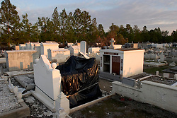 03 November, 2005.  New Orleans, Louisiana. Post Katrina.<br /> An empty tomb at the Terre Aux Boaeufs (cattle land) cemetery in Saint Bernard parish just south of New Orleans. Hurricane Katrina caused a 20ft tidal surge to sweep over the land, 'popping' tombs and displacing coffins.<br /> Photo; ©Charlie Varley/varleypix.com