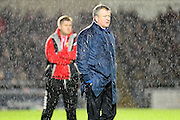 A soaked Cobblers boss Chris Wilder during  the The FA Cup match between Northampton Town and Milton Keynes Dons at Sixfields Stadium, Northampton, England on 9 January 2016. Photo by Dennis Goodwin.