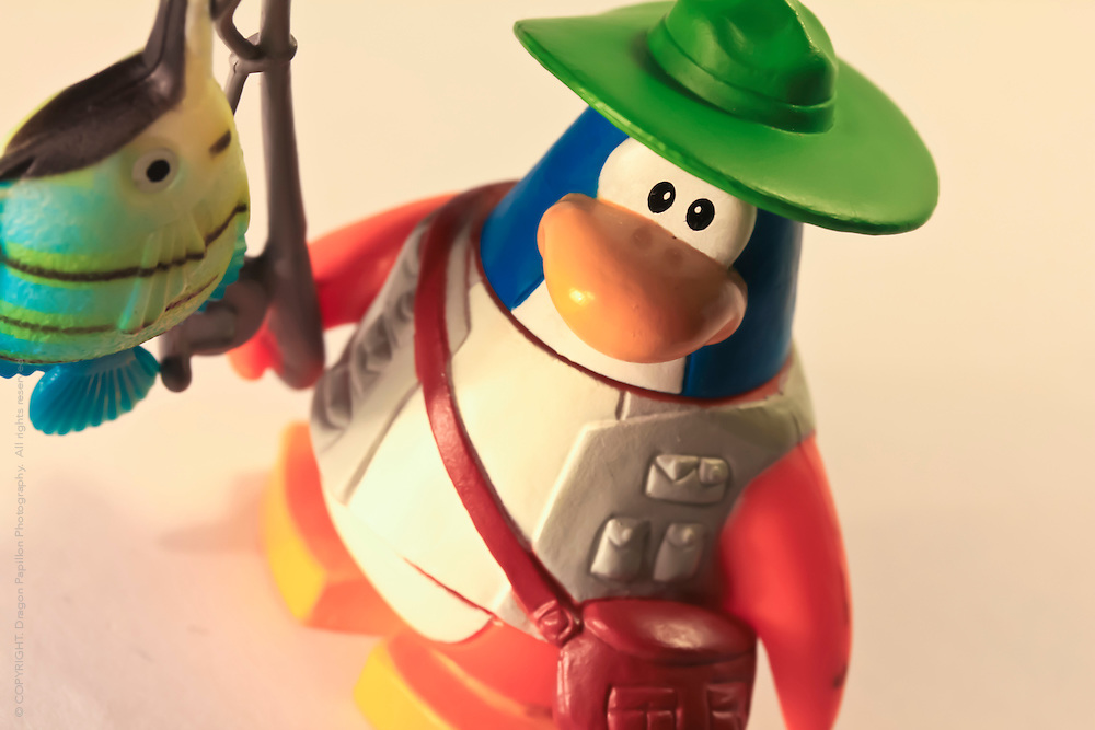 macro photography: children's toy club penguin fishing