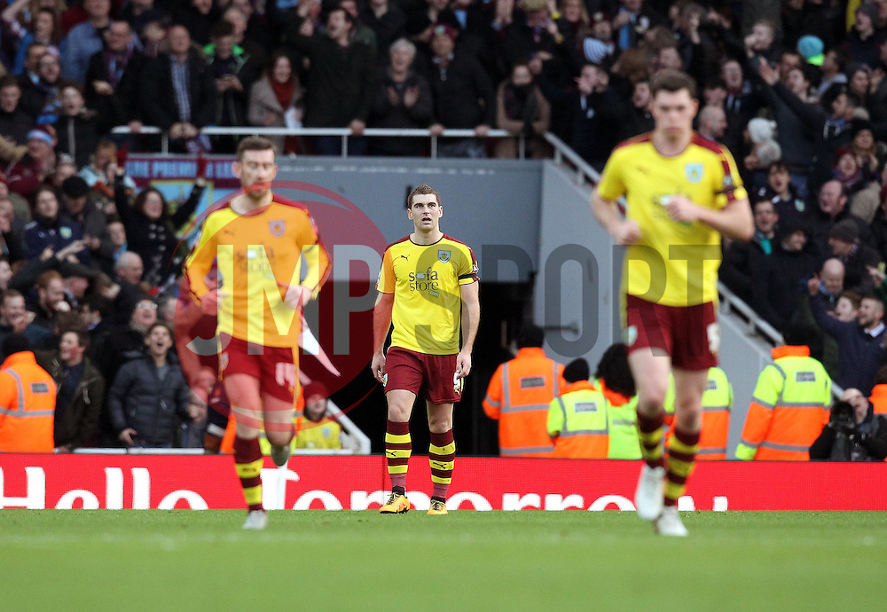 Sam Vokes of Burnley walks back to the centre circle after equalising against Arsenal - Mandatory byline: Robbie Stephenson/JMP - 30/01/2016 - FOOTBALL - Emirates Stadium - London, England - Arsenal v Burnley - FA Cup Forth Round