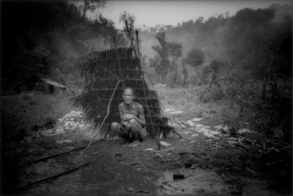 Agta Negrito headman, Pok, under a traditional Negrito lean-to shelter in Sawa, Sierra Madre Mountains, Luzon, Philippines.