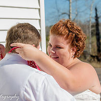 The bride removes the groom's blindfold during the big reveal
