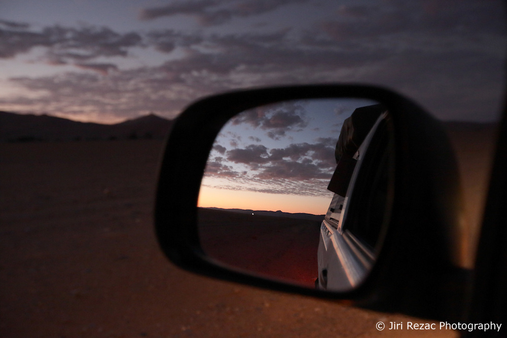 NAMIBIA SOSSUSVLEI APR14 - Sunset in the rearview mirror of a <br /> <br /> Toyota Hilux 4x4 vehicle on a road in Namibia.<br /> <br /> jre/Photo by Jiri Rezac<br /> <br /> <br /> <br /> © Jiri Rezac 2014