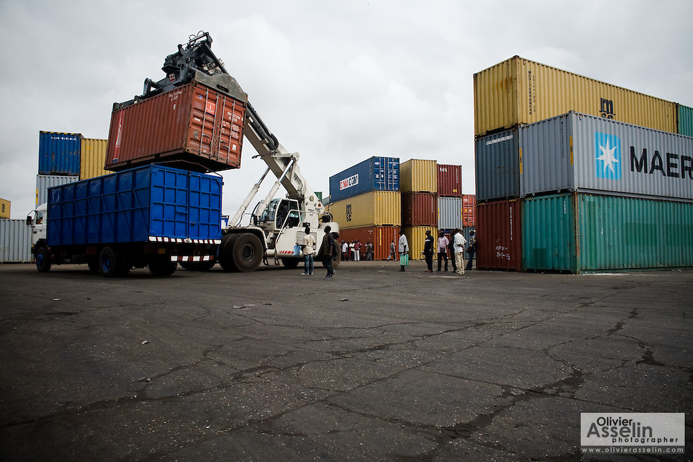 Containers are loaded aboard a truck at the sea port in Lome, Togo on Friday October 3, 2008.