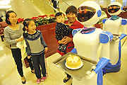 "NINGBO, CHINA - NOVEMBER 24: (CHINA OUT) <br /> <br /> Robots Act As Waiters<br /> <br /> Robots act as waiters provide service for consumers at a dinning hall at Living All square on November 24, 2014 in Ningbo, Zhejiang province of China. Lu Dike, a former e-commerce worker opened an ""Robot Dinning Hall\"" in which waiters were two robots. The robots can communicate basic expressions and are worked by light induced magnetic stripe. One robot costed sixty thousands and could work five years within eight hours per day after charging for four hours. The robots acting as waiters were cheaper than labor and never be tired. <br /> ©Exclusivepix"