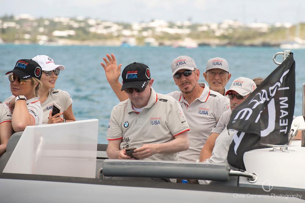 The Great Sound, Bermuda, 17th June Oracle Team USA owner Larry Elison (waving) aboard a team chase boat before racing on day one of the America's Cup.