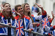 London, 10th September 2012. Women athletes wave to spectators the day after the end of the London 2012 Paralympics as thousands lined the capital's streets to honour 800 of TeamGB's athletes and Paralympians. Britain's golden generation of athletes in turn said thank you to its Olympic followers, paying tribute to London and a wider Britain as up to a million people lined the streets to celebrate the ?greatest ever? sporting summer and billed to be the biggest sporting celebration ever seen in the UK.