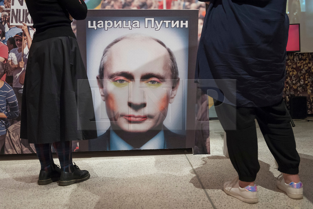 """© Licensed to London News Pictures. 27/03/2018. LONDON, UK. """"Gay Clown Putin artwork"""", Amsterdam, 2016. In 2017, the Russian state outlawed a mock-up of Putin wearing colourful, clown make-up listing it as 'extremist' item 4071. Preview of """"Hope to Nope: Graphics and Politics 2008-18"""", an exhibition examining the political graphic design of a turbulent decade encompassing the 2008 financial crash, Barack Obam presidency, Brexit and Donald Trump's presidency.  The exhibition takes place at the Design Museum 28 March to 12 August 2018.  Photo credit: Stephen Chung/LNP"""