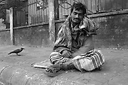 ADG (10): An addict sits on the street and he has been suffering unknown disease. Her right leg is already infected and a number of insect sit on  his leg but he is dong nothing and useless. Dhaka. January 2009 &copy; Monirul Alam  <br /> <br /> A Deadly Game | Moniul Alam<br /> <br /> No one can help me, so I don&rsquo;t have any other way except begging. I leave on the street and everyday earn taka 30/40. I am also taking drugs for frustrating my life hood.<br /> &nbsp;&nbsp;&nbsp;&nbsp;&nbsp;&nbsp;&nbsp;&nbsp;&nbsp;&nbsp;&nbsp;&nbsp;&nbsp;&nbsp;&nbsp;&nbsp;&nbsp;&nbsp;&nbsp;&nbsp;&nbsp;&nbsp;&nbsp;&nbsp;&nbsp;&nbsp;&nbsp;&nbsp;&nbsp;&nbsp;&nbsp;&nbsp;&nbsp;&nbsp;&nbsp;&nbsp;&nbsp;&nbsp;&nbsp;&nbsp;&nbsp;&nbsp;&nbsp;&nbsp;&nbsp;&nbsp;&nbsp;&nbsp;&nbsp;&nbsp;&nbsp;&nbsp;&nbsp;&nbsp;&nbsp;&nbsp;&nbsp;&nbsp;                      &nbsp;-Zahid, a street bagger &amp; drug user<br /> A lame man is walking on the street at night. His name is Zahid who lost his left leg by suffering typhoid since his childhoods he said, after years he came to Dhaka from his village Bagura north part of Bangladesh and start begging for surviving. He said no one can help me, so I don&rsquo;t have any other way except begging. I leave on the street and everyday earn taka 30/40. I am also taking drugs for frustrating my life hood. Some time the police pick me up from the street and release outskirts of Dhaka. We suffer a lot but no one can help us for a good job or rehabilitations. Like Zahid, many number of people who where suffering inhuman life and every day violating their human rights. Particularly women and girls is a grave violation of human rights. It can include physical, sexual, psychological and economic abuse, which cuts across boundaries of age, race, culture, wealth and geography.  <br /> According to health ministry as of last year, 123 people died of AIDS,365 others got infected and 1207 found HIV positive. The first HIV positive patient in the country was identified in 1989. Drug abuse directly influences the economic and social aspects of a country. In Bangladesh it is a growing national concern. <br /> <br /> There are millions of drug-addicted people in Bangladesh and most of them are young, between the ages of 18 and 30. And they are from all strata of the society. Althoug