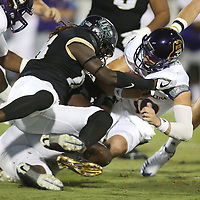 ORLANDO, FL - OCTOBER 14: Shaquem Griffin #18 of the UCF Knights stops Thomas Sirk #10 of the East Carolina Pirates for a loss during a NCAA football game between the East Carolina Pirates and the UCF Knights at Spectrum Stadium on October 14, 2017 in Orlando, Florida. (Photo by Alex Menendez/Getty Images)