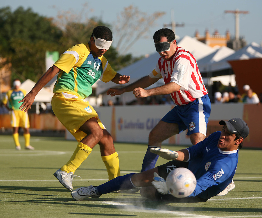 Rio de Janeiro_RJ, Brasil...Atletas disputam futebol de 5 nos jogos Parapan 2007. Na foto o jogador brasileiro,Joao Silva disputa bola com o capetao paraguaio ,Evelio Pavon e o goleiro Nicolas Yegros...The athletes in Parapan 2007. In this photo the Brazilian soccer player Ricardo Alves (Ricardinho) and Capeta, Paraguayan, Evelio Pavon and the goalkeeper Nicolas Yegros...Foto: MARCUS DESIMONI / NITRO...