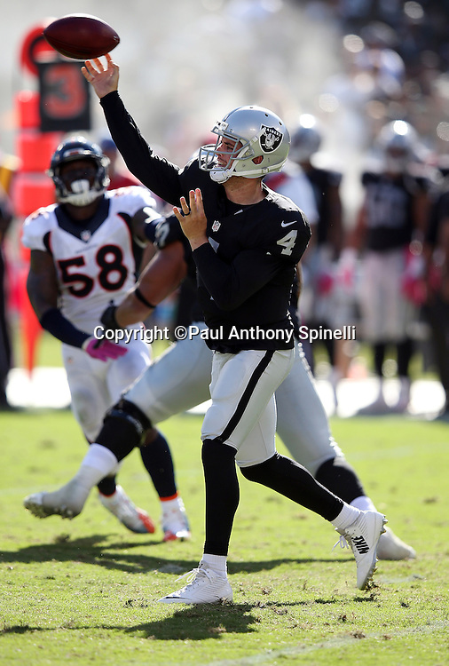 Oakland Raiders quarterback Derek Carr (4) throws a pass during the 2015 NFL week 5 regular season football game against the Denver Broncos on Sunday, Oct. 11, 2015 in Oakland, Calif. The Broncos won the game 16-10. (©Paul Anthony Spinelli)