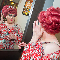 Female impersonator Wayne Chamberlain, the reigning Miss Gay Portland XLI, checks her personna in the mirror at CC Slaughter's nightclub in Portland.12:28am