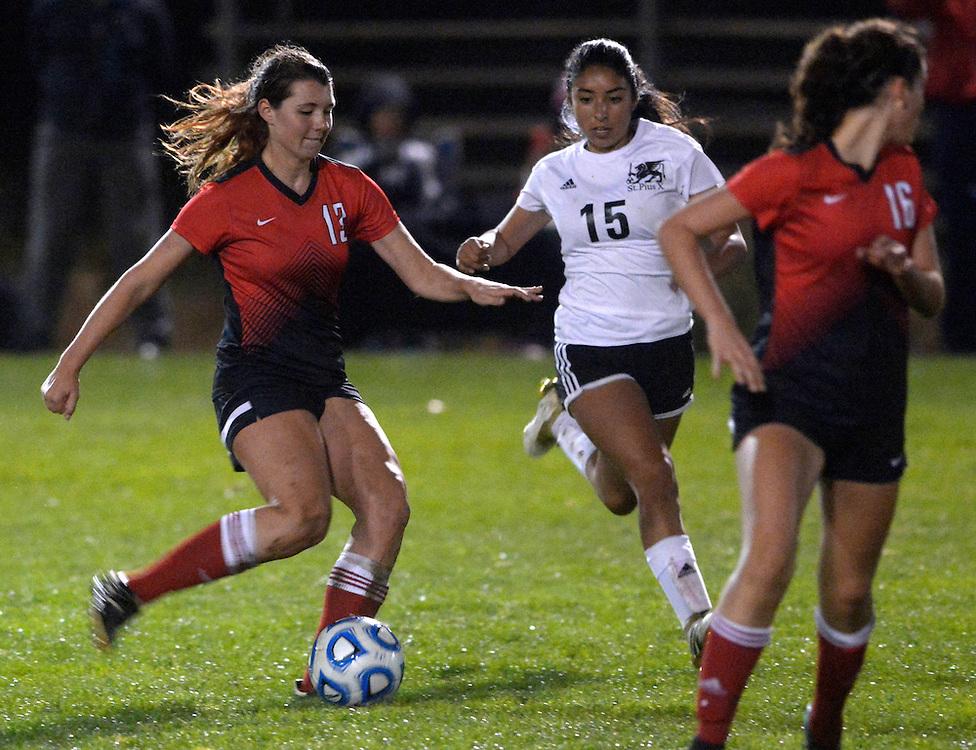gbs110516v/SPORTS -- Albuquerque Academy's Alli Leggott, 13, kicks past Stpius' Esperanza Chavez, 15, during the 5A State Soccer Championship on Saturday, November 5, 2016.  (Greg Sorber/Albuquerque Journal)