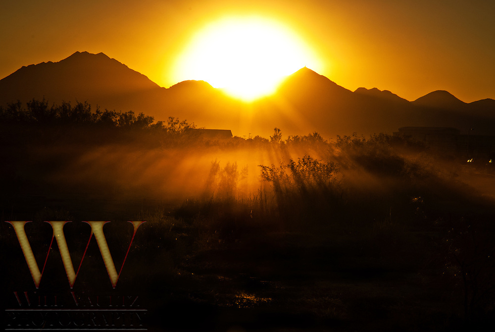 Orange morning sun on foggy landscape.
