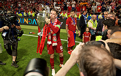 MADRID, SPAIN - SATURDAY, JUNE 1, 2019: Liverpool's captain Jordan Henderson with the trophy after the UEFA Champions League Final match between Tottenham Hotspur FC and Liverpool FC at the Estadio Metropolitano. Liverpool won 2-0 to win their sixth European Cup. (Pic by David Rawcliffe/Propaganda)