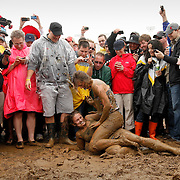 Sarah Silverstein, top, wrestles Kelly Schwerzler during a mud pit challenge in the infield during the 136th running of the Kentucky Derby at Churchill Downs Saturday May 1, 2010. Photo by David Stephenson