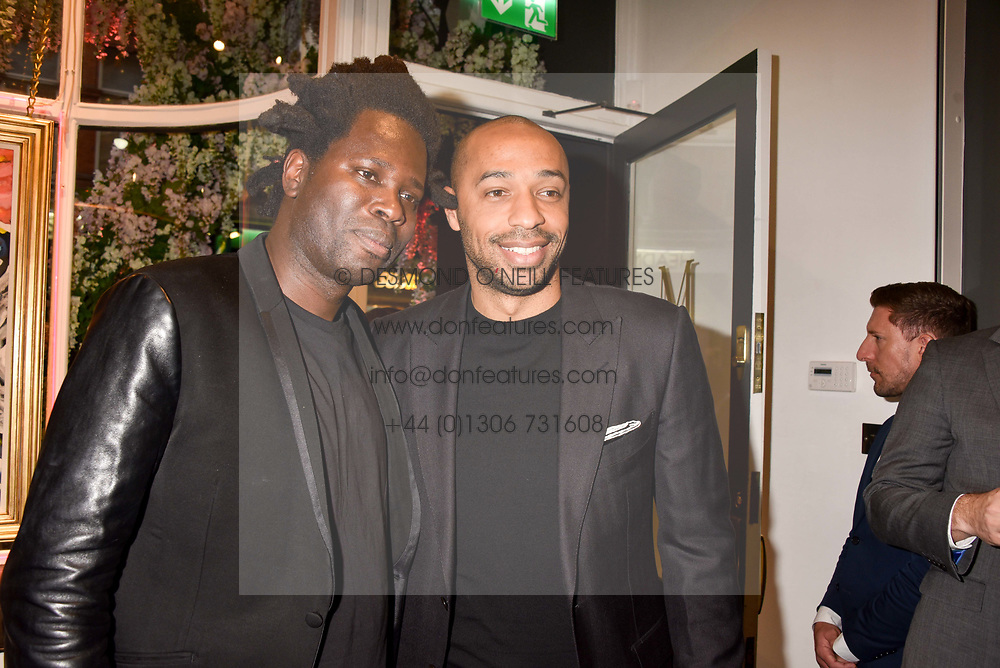 Left to right, artist Bradley Theodore and Thierry Henry at a private view of work by Bradley Theodore entitled 'The Second Coming' at the Maddox Gallery, 9 Maddox Street, London England. 19 April 2017.